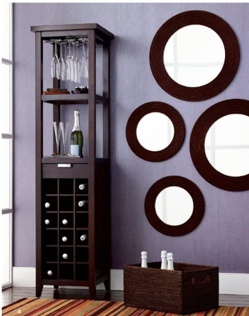 Decoraci n interiores espejos redondos en las paredes for Espejos circulares decorativos