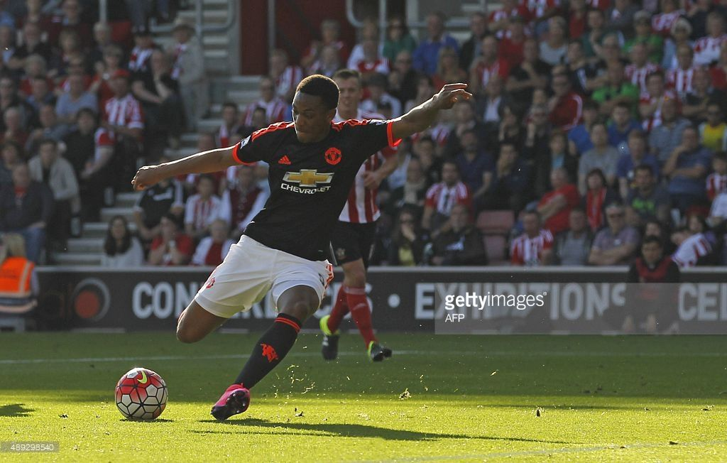 Manchester United's French striker Anthony Martial shoots