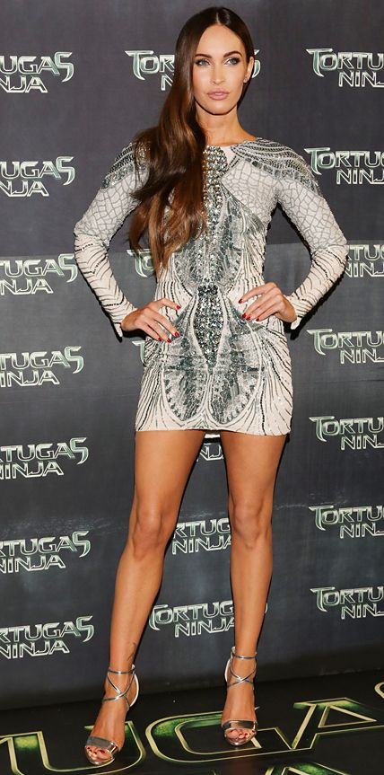 Megan Fox struck a fierce pose at the Mexico City premiere of Teenage Mutant Ninja Turtles in a stunning long-sleeve white silk Zuhair Murad dress with silver-and-slate blue beaded embroidery, complete with silver strappy Brian Atwood sandals
