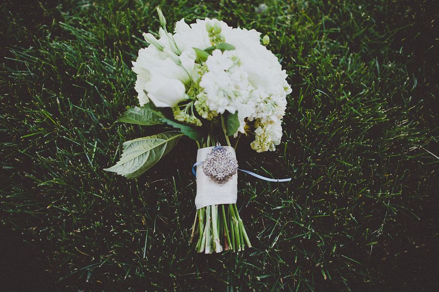 White Wedding bouquet with antique broach - ©Ryan Flynn Photography. www.ryanflynnphotography.net