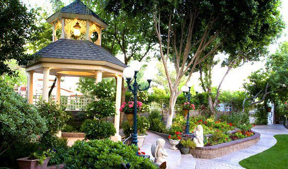 View of the gazebo from the stage in the beautiful gardens at the perfect wedding junglespirit Choice Image