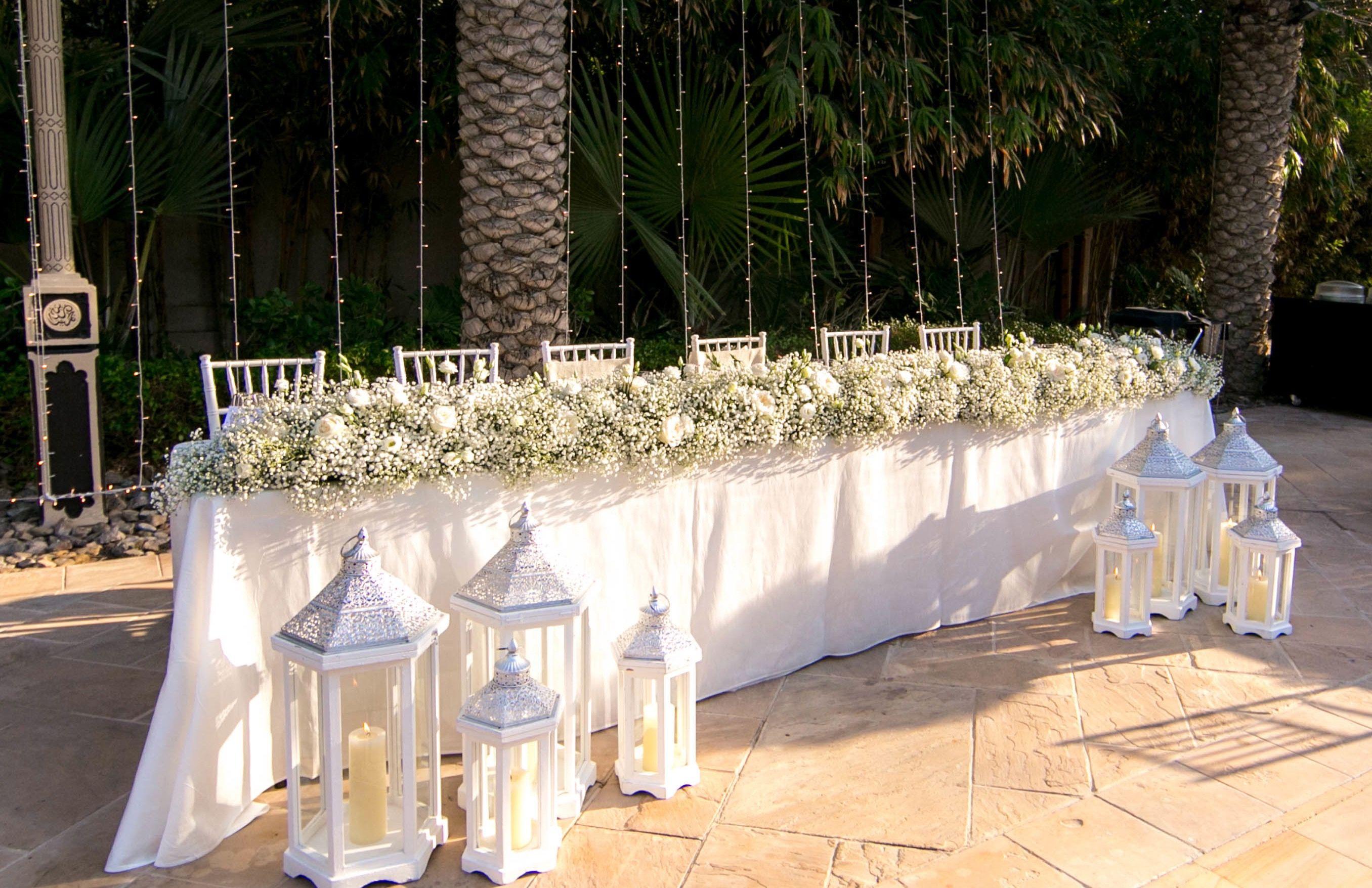 Wedding stage decoration dubai  BLISS flower boutique arrangement  DUBAI  TABLE SET UP  Pinterest