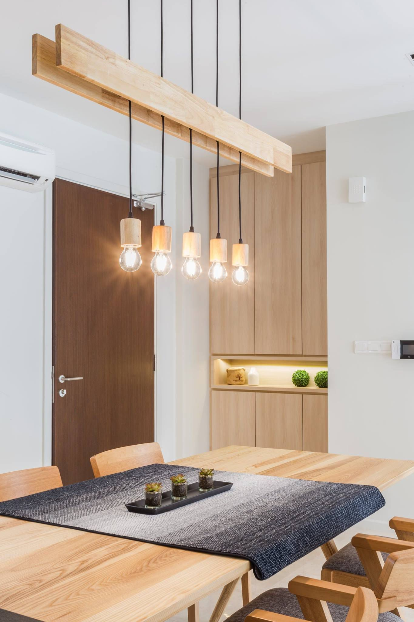 Stunning Wooden Light Fixture Hangs Over The Dining Area Wooden Light Fixtures Lighting Design Interior Wooden Lamps Design