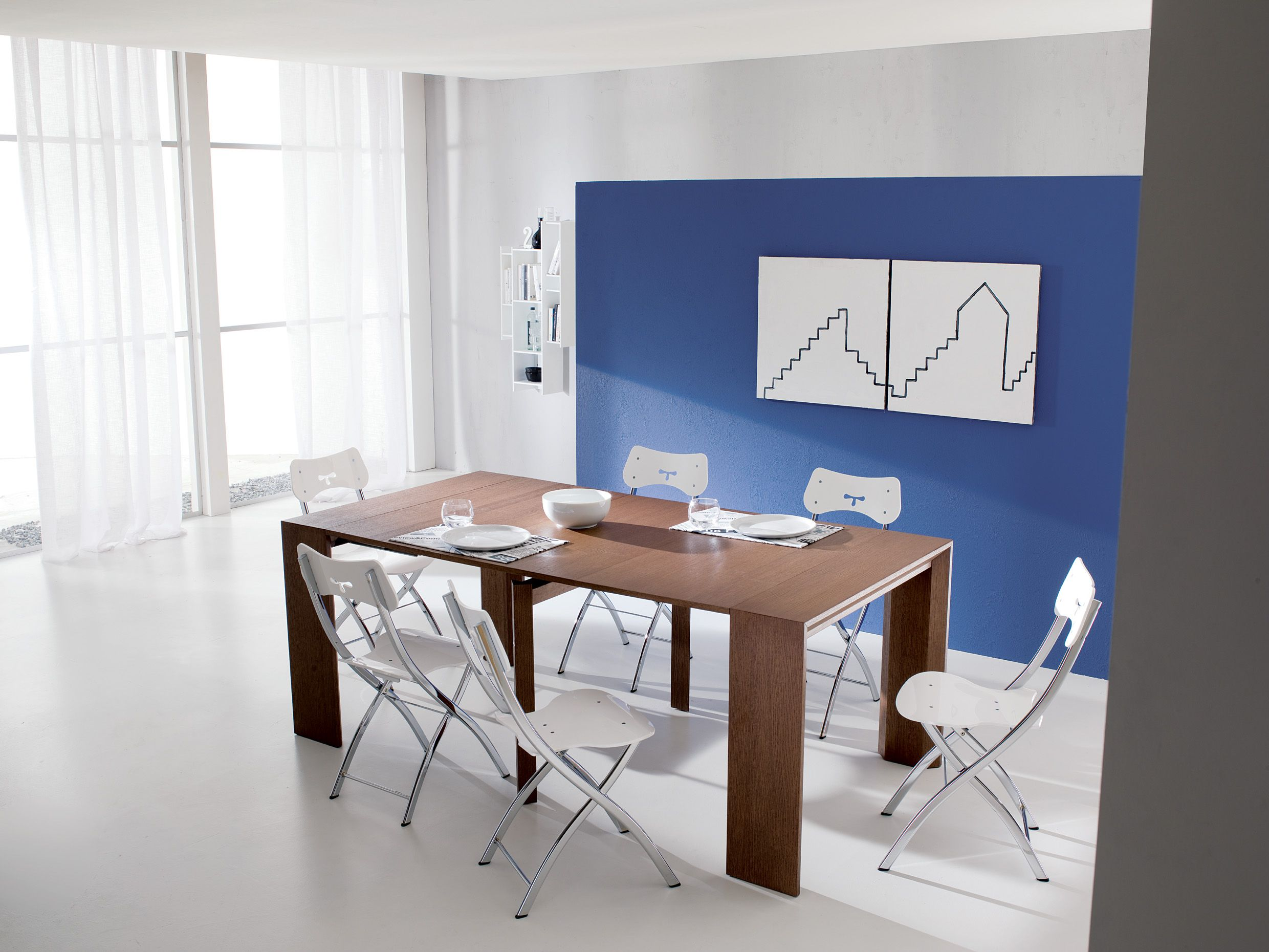 Golia by ozzio is a console that can seat up to 10 people when goliath space saving table the goliath transforming table extends from a console size of 17 inches to a dining size of 115 inches utilizing a unique geotapseo Gallery
