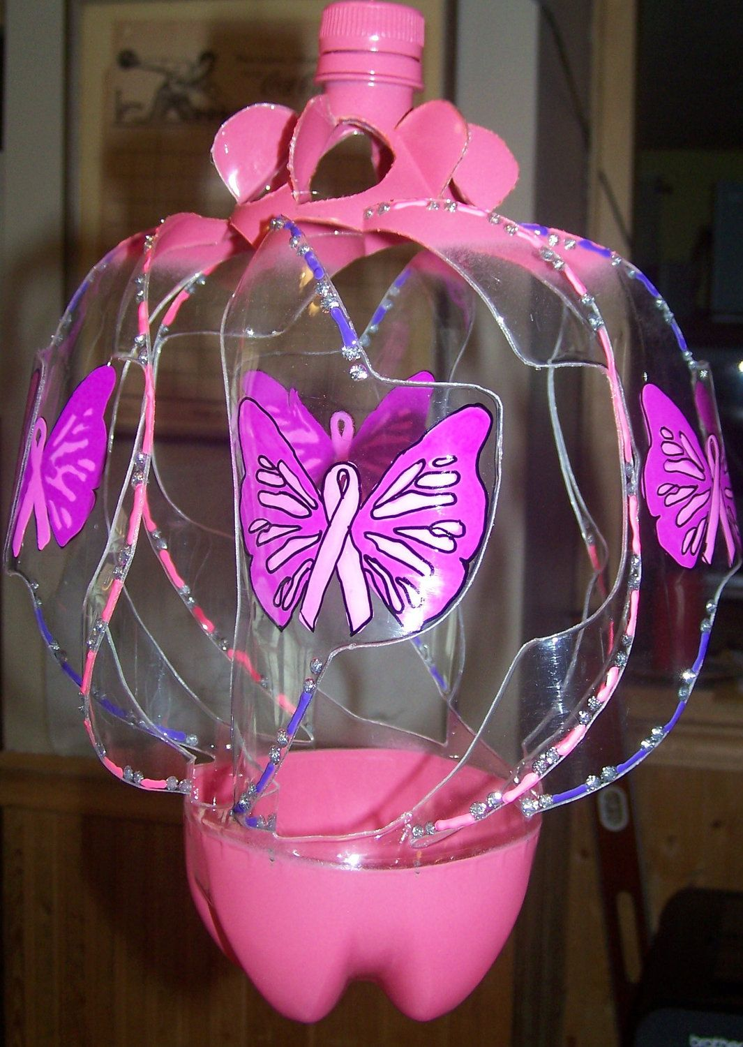 Upcycled plastic soda bottle cancer ribbon with butterfly for Crafts made from plastic bottles