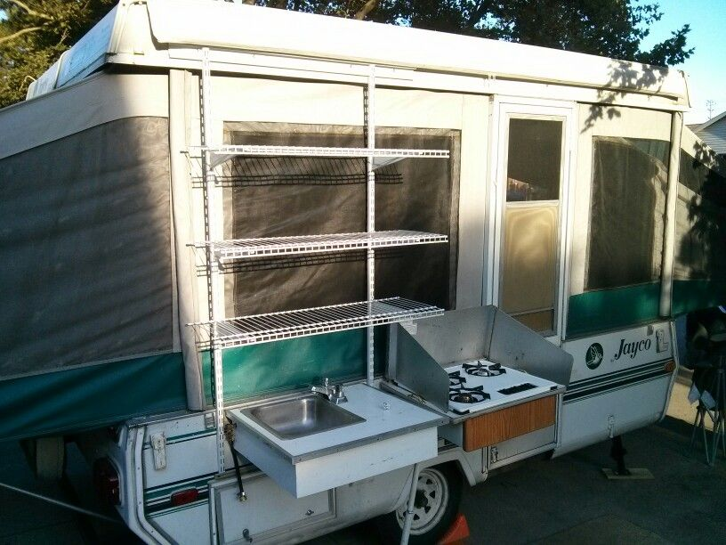 Simple Solution To A Lack Of Outdoor Kitchen Shelving On Our Pop Up Camper Using Closetmaid Selftrack Outdoor Camping Kitchen Pop Up Camper Camp Kitchen
