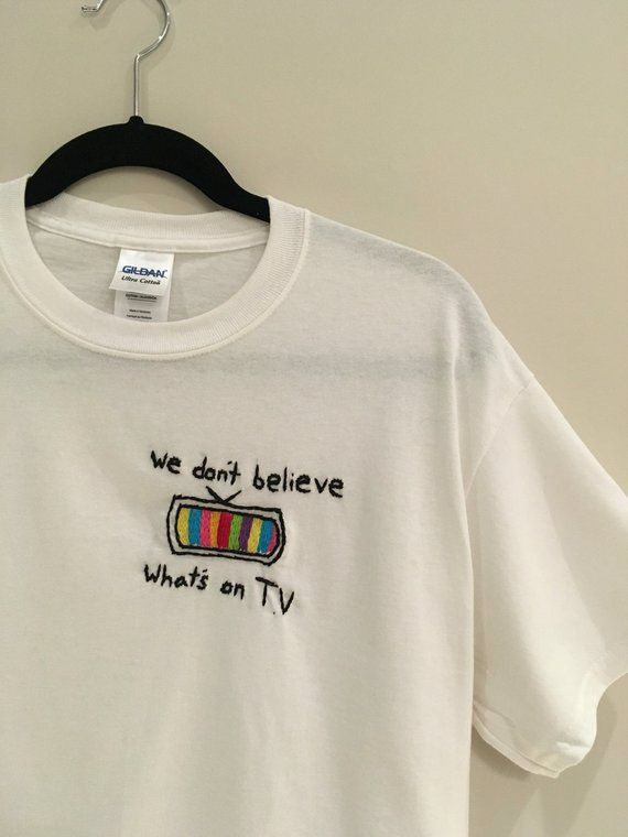 We Don't Believe Whats's on T.V Embroidered T-Shirt #teacherchristmasgiftideas