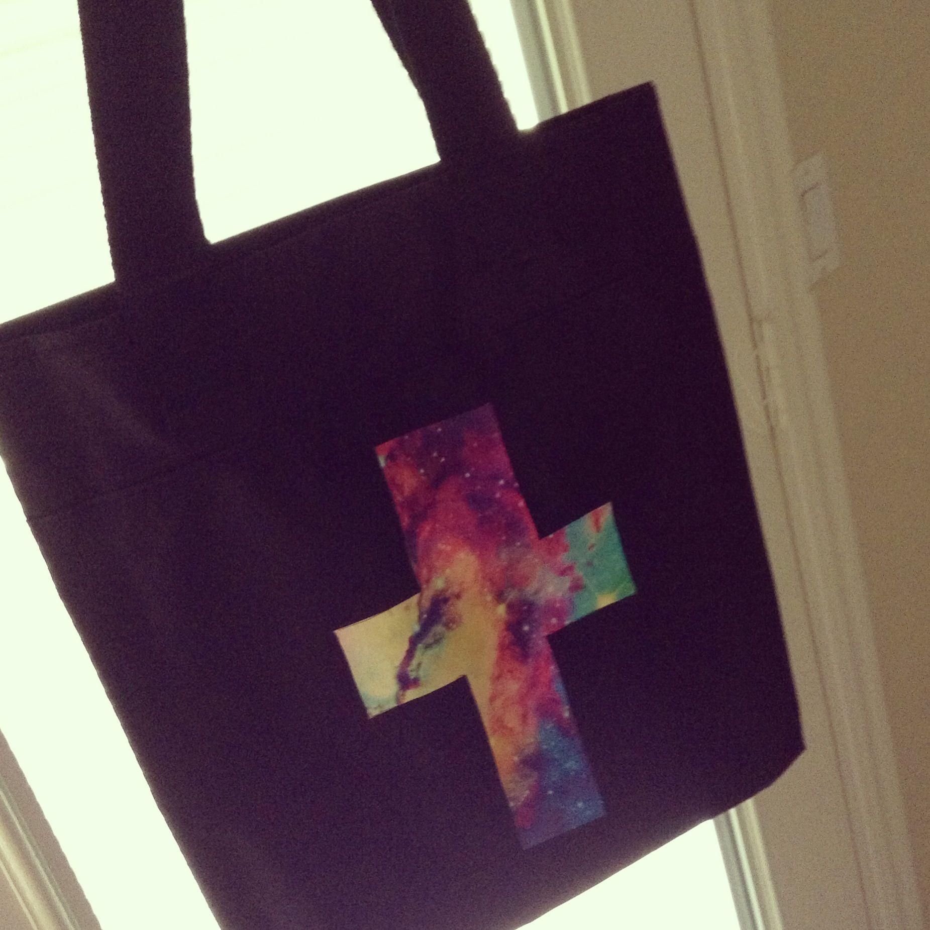 DIY galaxy cross purse  Materials  Blank canvas bag Dark fabric transfers   Printout galaxy print  Cut out a cross iron it onto bag