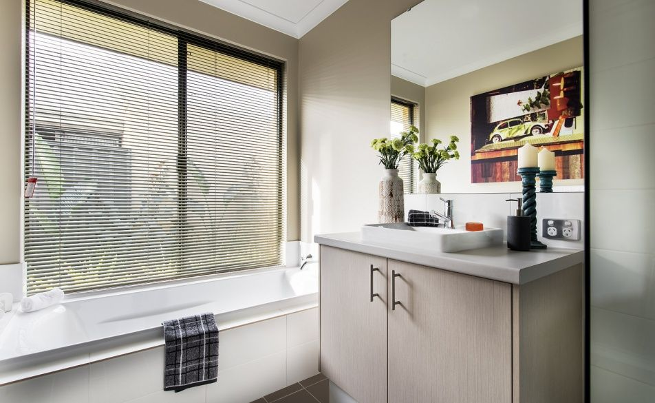 Stylish bathrooms with glass semi frameless pivot screen doors