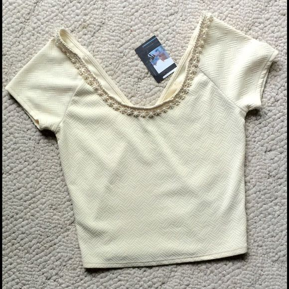 ANTHROPOLOGIE Ivory Crop Top Stretchy crop top. NWT. Anthropologie Tops Crop Tops