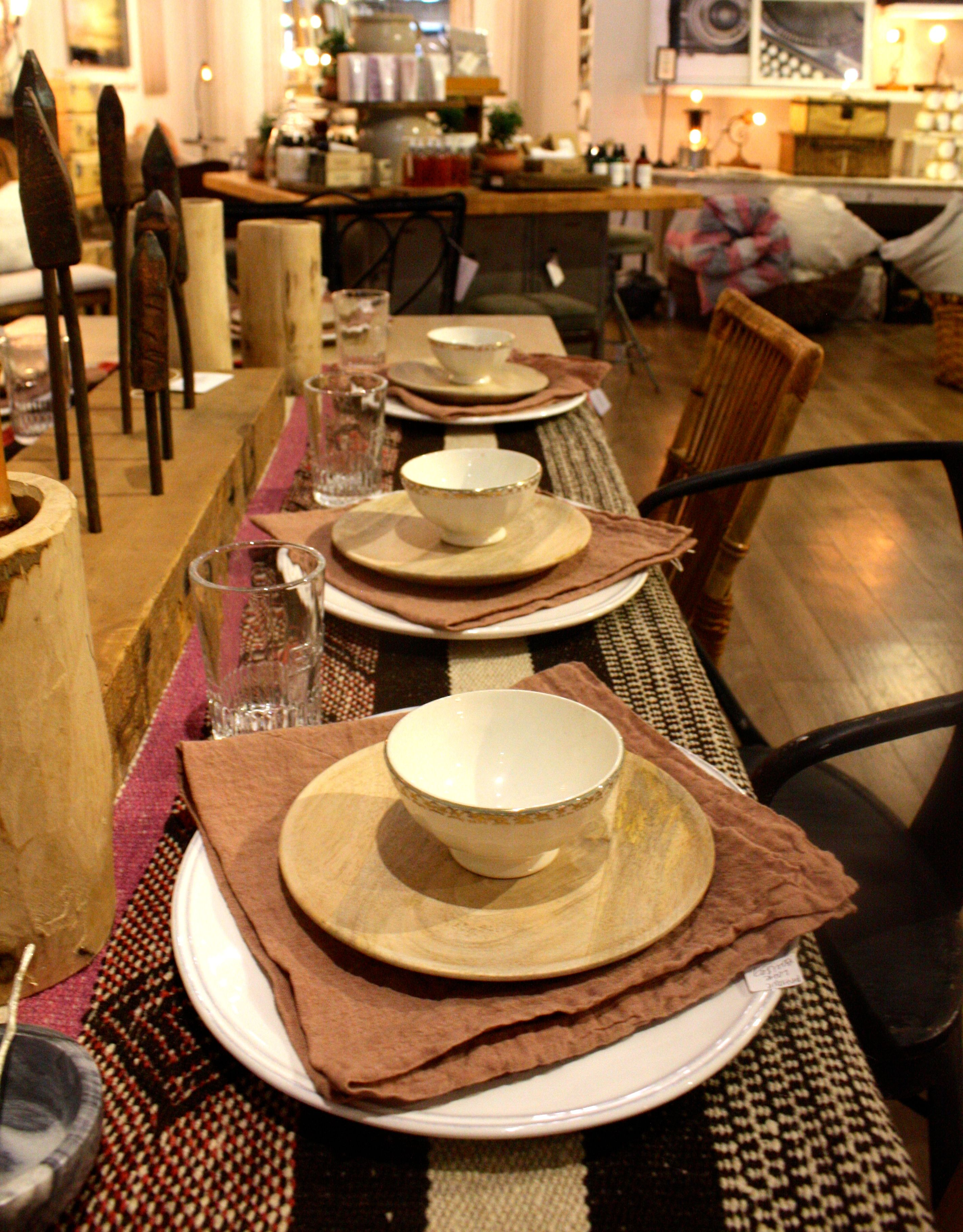 Antique French Latte Bowls, Handwoven Peruvian Rugs make a perfect table setting at A Beautiful Mess.