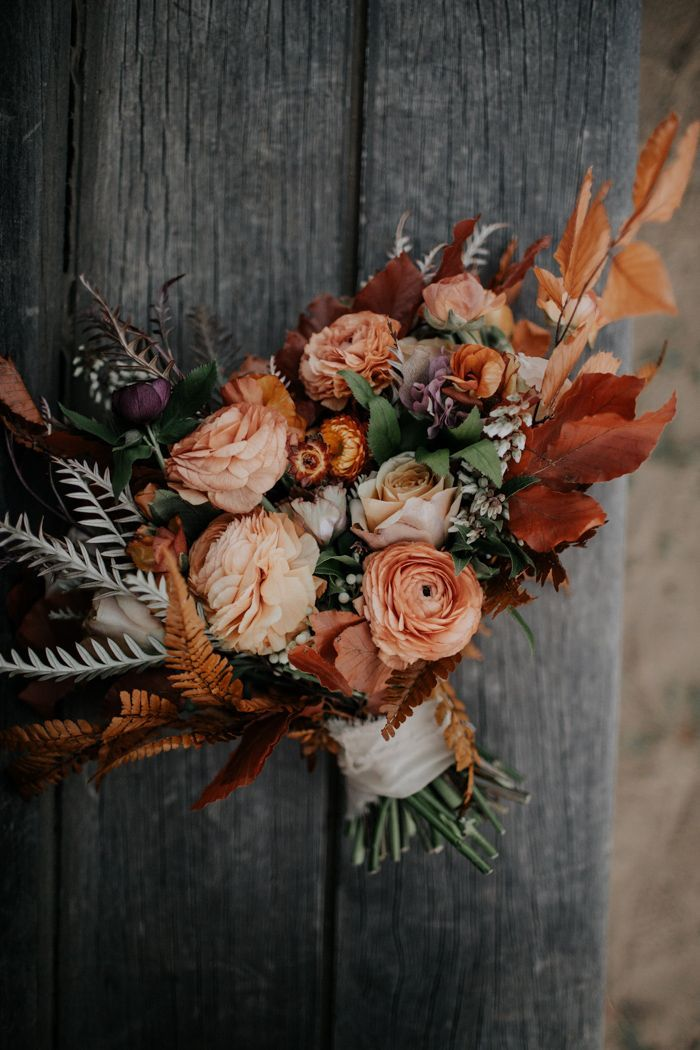 If You Love the Trending Rust and Orange Color Palette, This Retro Wolf Feather Honey Farm Wedding Inspiration is for You | Junebug Weddings #weddingfall