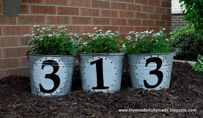 Cute idea for the front flower bed!! House numbers on some old buckets! #flowerbeds
