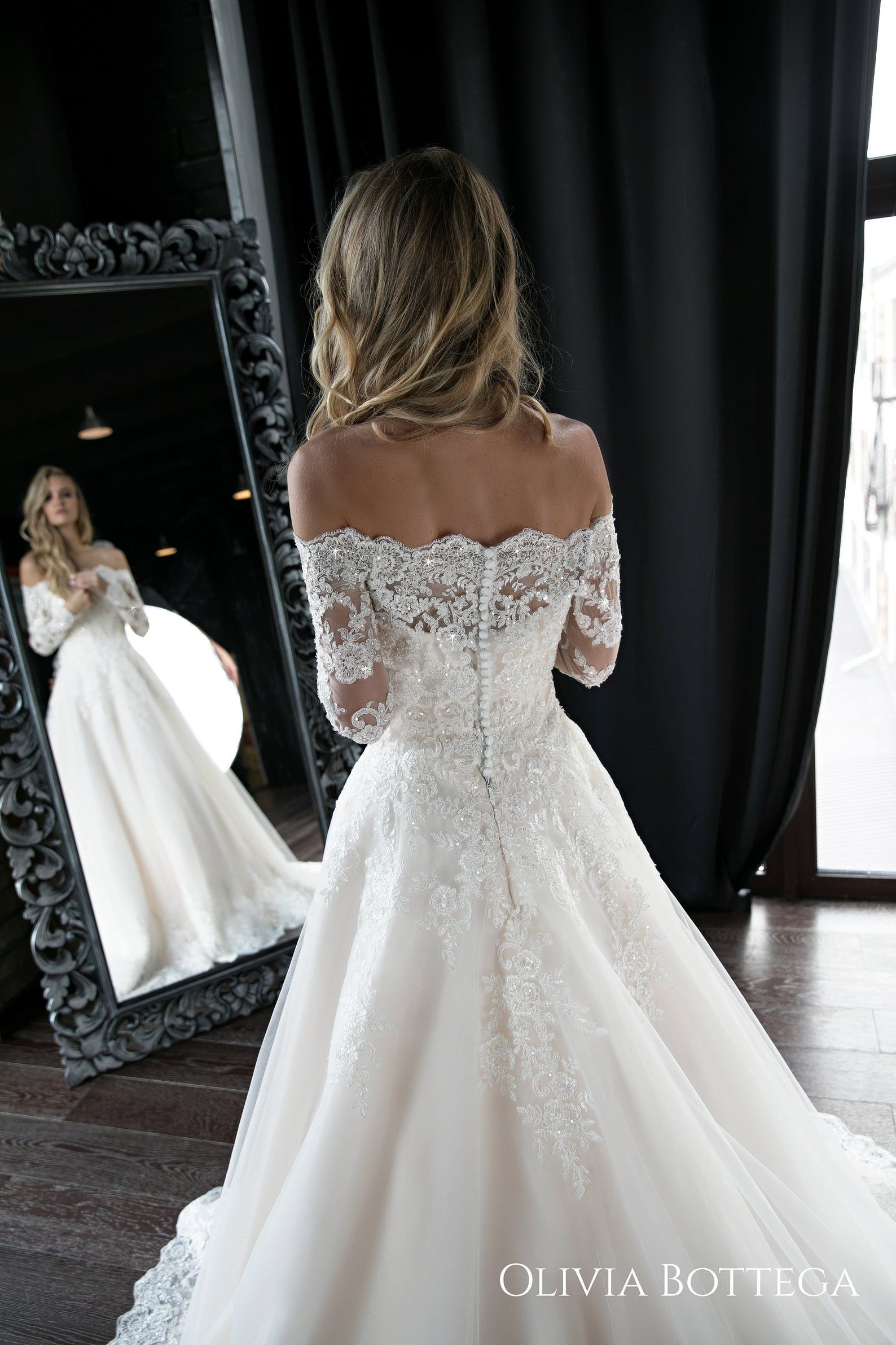 A line wedding dress Olivia by Olivia Bottega. Wedding dress off the shoulder