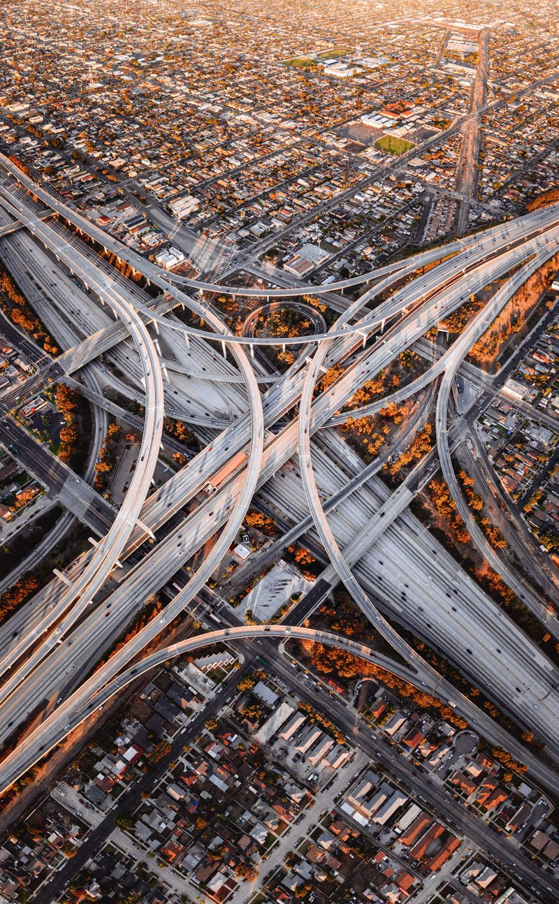 Los Angeles Aims For 25 Less Greenhouse Gas Emissions By 2028 Electric Vehicles Are The Key Aerial Photography Drone Aerial Photography City Aerial
