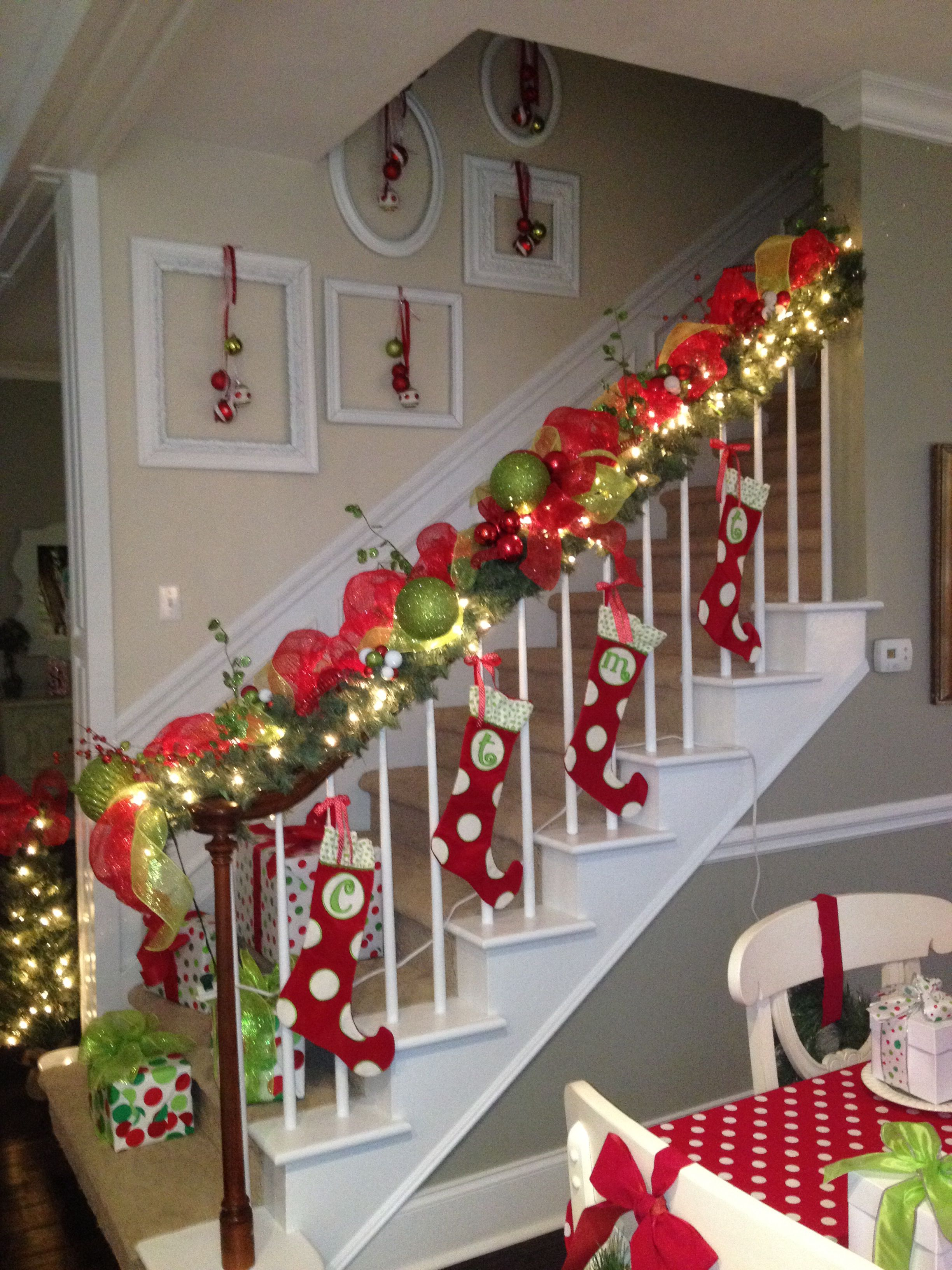 tied stockings to railings with ribbon hung ornaments on antique picture frames christmas crafts - Decorating Banisters For Christmas With Ribbon