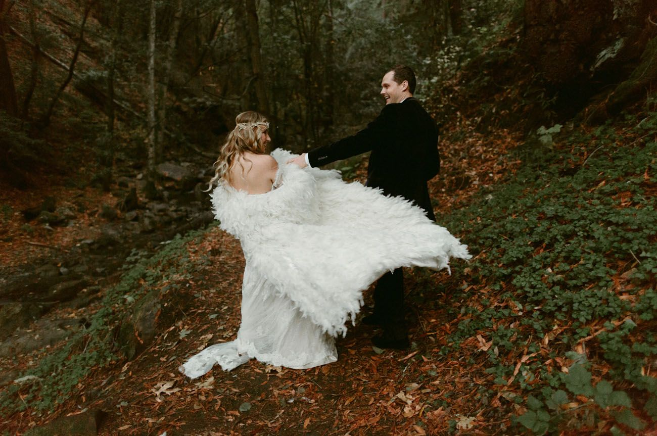 A fairytale forest wedding with a feather cape feather cape