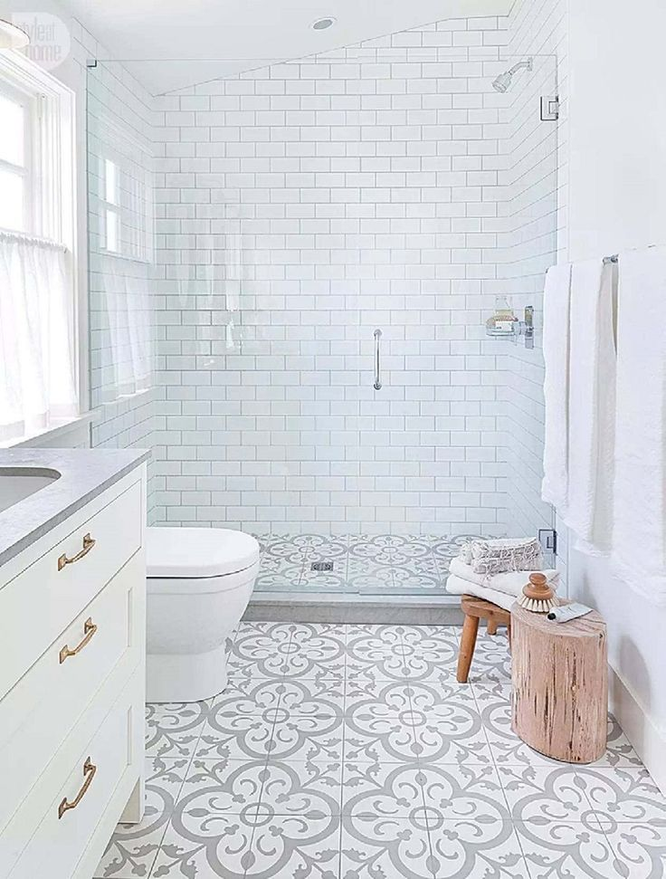 modern farmhouse bathroom with bold pattern cement tile floring style at home guest bath floor cabinet and shower - Best Tile For Bathroom Floor