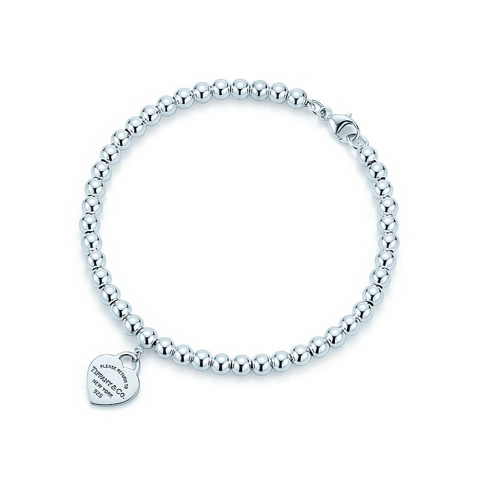 81f47297b Return to Tiffany® mini heart tag in sterling silver on a bead bracelet. |  Tiffany & Co.