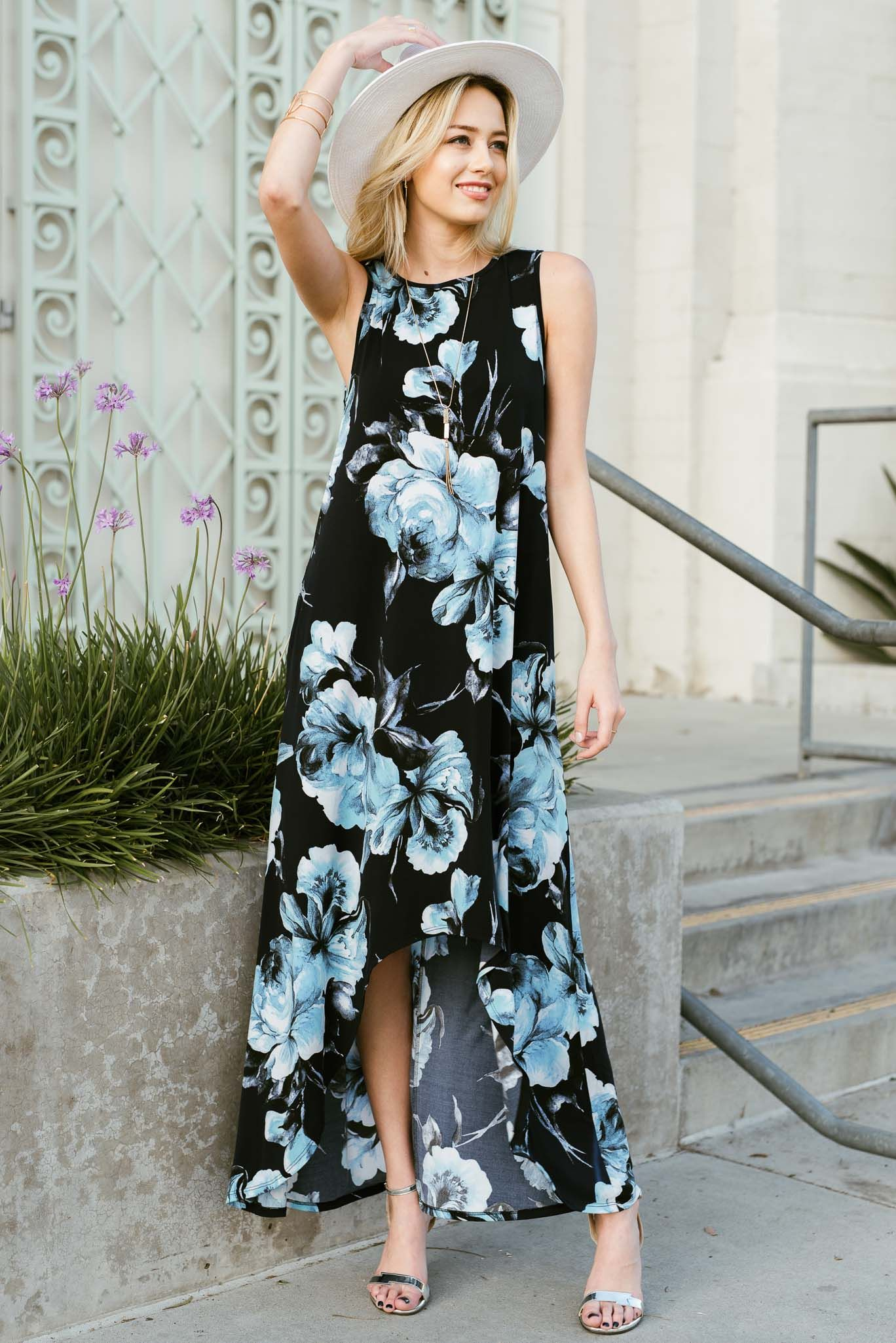 529836485aa Floral sleeveless high low maxi dress featuring hidden pocket ...