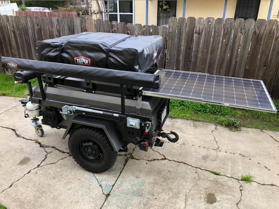 Keak S M416 Trailer With A Slide Out 300w Solar Panel Installed Under His Roof Top Tent Supported On Diy No Weld In 2020 Diy Roof Top Tent Camping Trailer Solar Panels