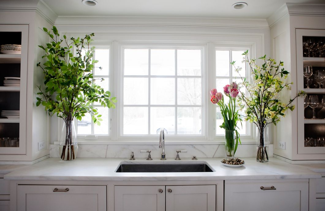 Low And Large Window Over Sink Glass Door Cabinetry On Sides Of Windows Reflects The Light And Deep Ca Marble Countertops Kitchen Home Kitchens Kitchen Design