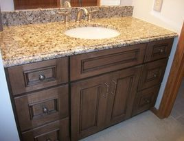 venetian gold granite on cherry cabinets with oil rubbed