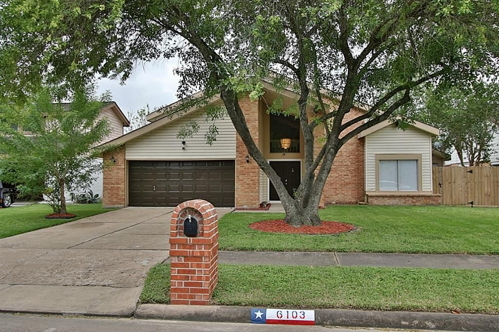 Cozy and inviting curb appeal at 6103 Downwood Forest