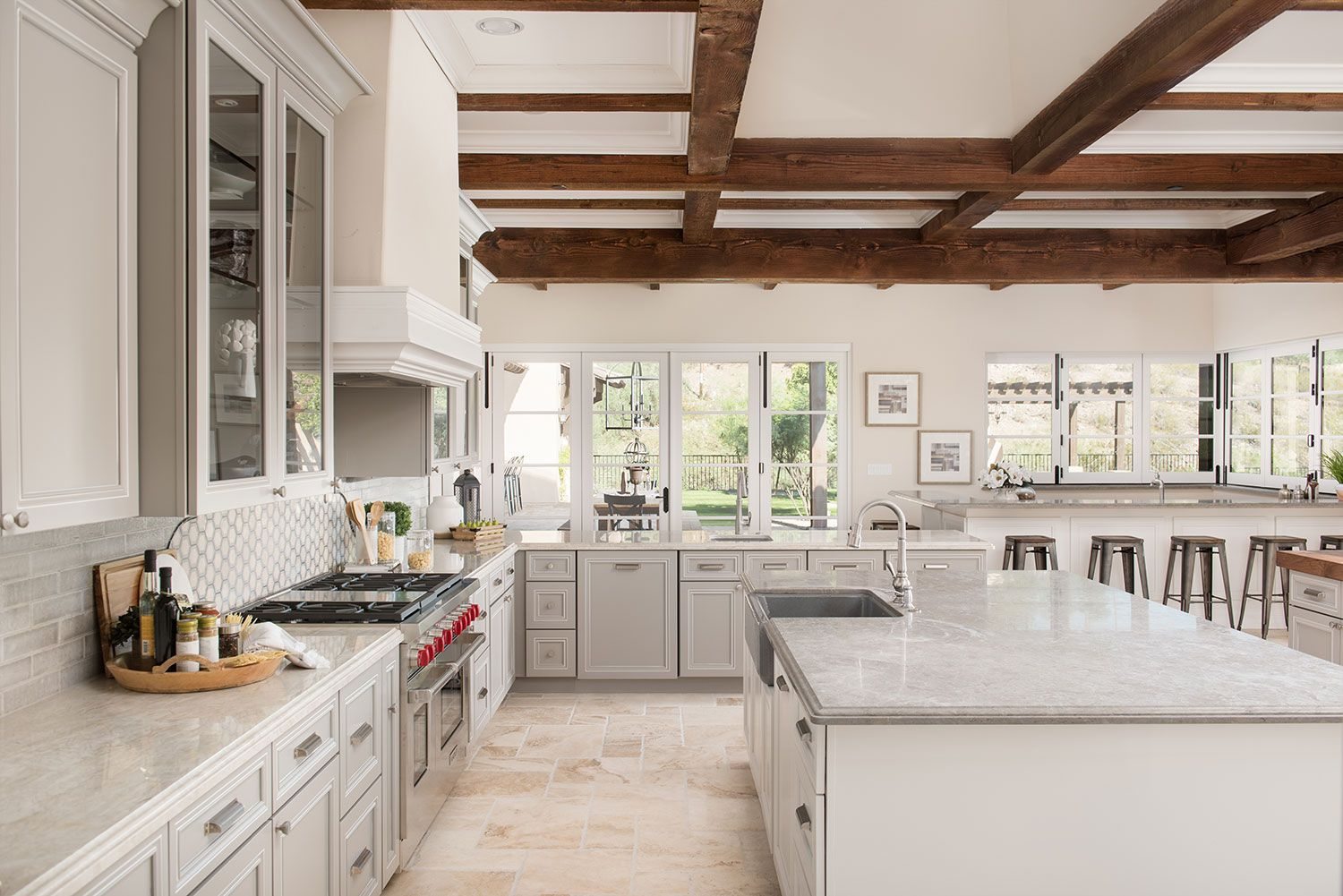 This Bright Kitchen With Lots Of Windows And Seating Uses The Corona Door Style In Gray Paint Wi Mexican Style Kitchens Bright Kitchens Custom Kitchen Cabinets