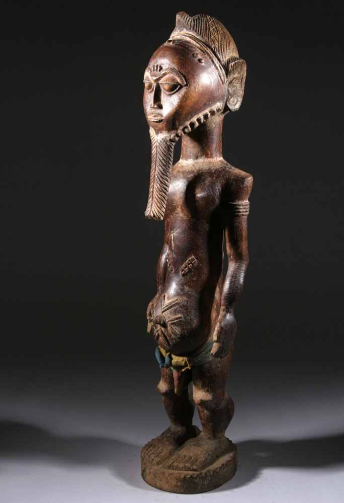 Africa | Male statue from the Baule people of the Ivory Coast | Carved wood, textile belt