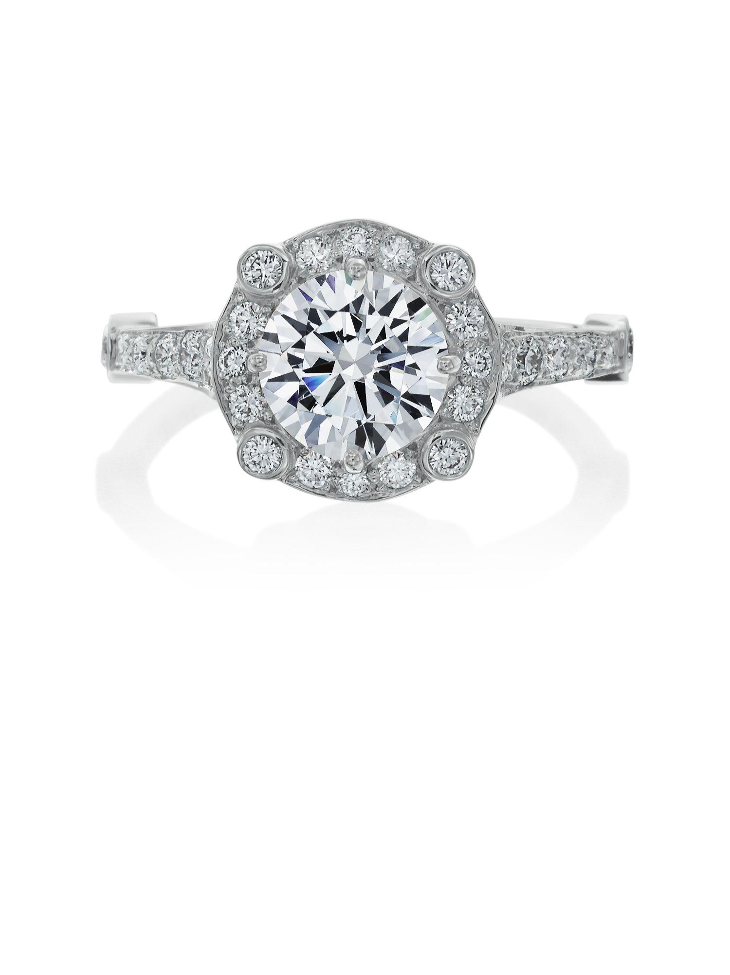 Beautiful halo platinum engagement ring. See more at