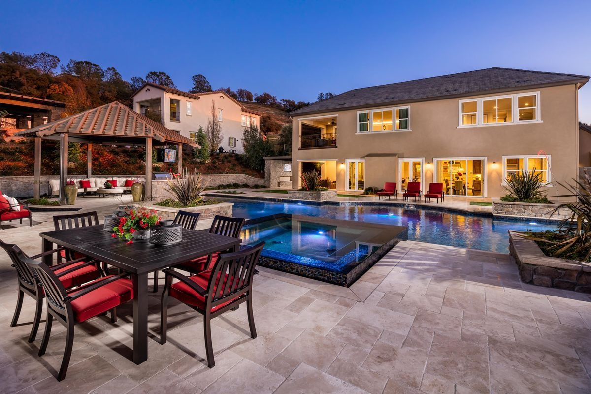 perfect outdoor living area by the pool at one of our homes in