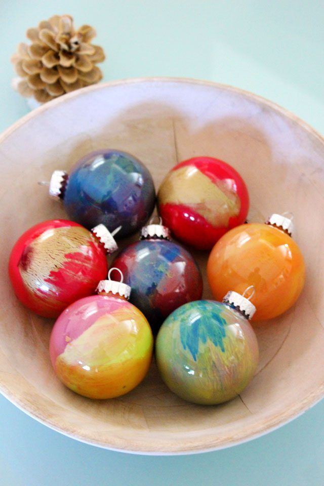 These marbleized glass ornaments are made by swirling wet paint inside  clear glass balls and letting the colors mix. - How To Paint Glass Ball Ornaments Christmas Pinterest