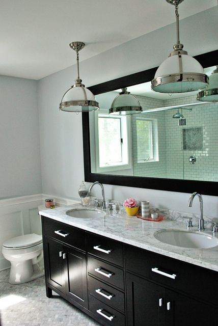 Master - herringbone marble tiles, subway tiles for shower,  black mirror/cabinet vanity