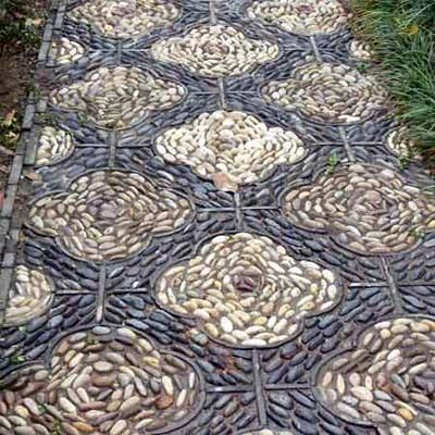 Cobbles installed in a repeating, runner-like pattern make a simple walkway feel special. Here the stones are installed on edge, so make sure to pack them tightly together and vary their direction. | Photo: Gisling | thisoldhouse.com