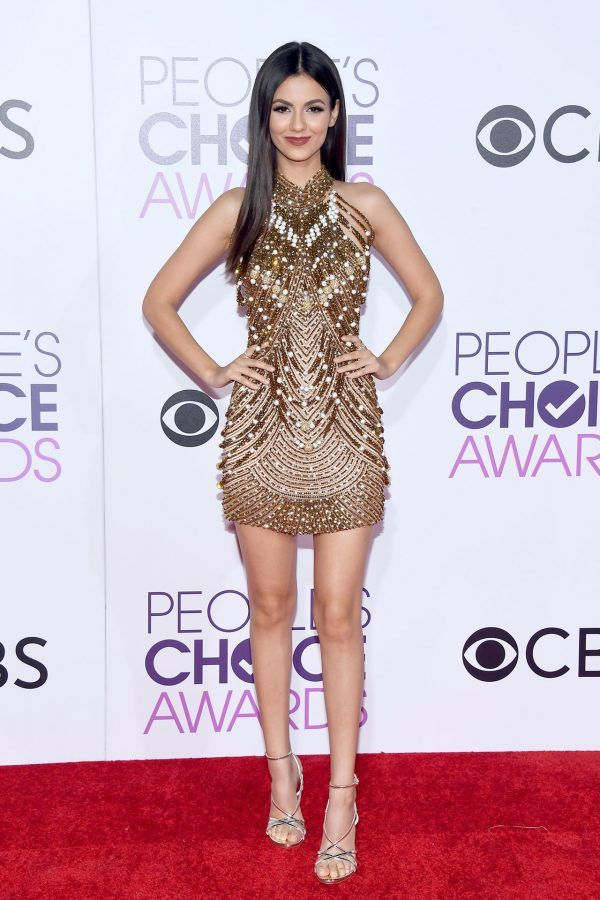 Victoria Justice in gold & bronze beaded Yousef Al-Jasmi gown