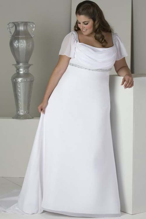 ad9a20a99b00e This simple wedding gown has sheer flutter  sleeves to cover the top  portion of the arm. The open neckline features the bust. There is an empire  waist line ...