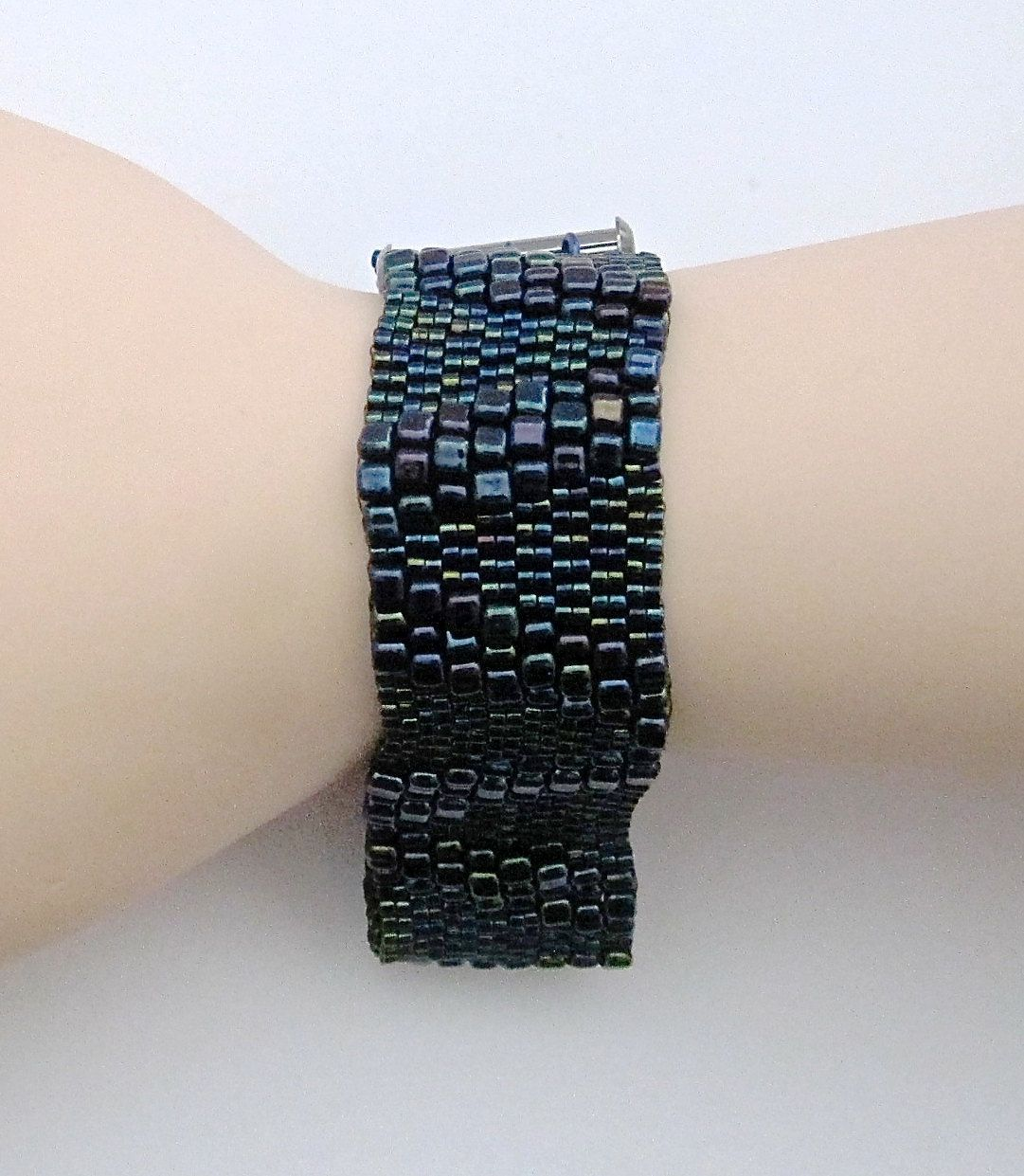 The Three of V Beaded Wrist Cuff Bracelet features Miyuki Japanese seed beads, gunmetal finished 3-strand sliding tube clasp and niobium jump