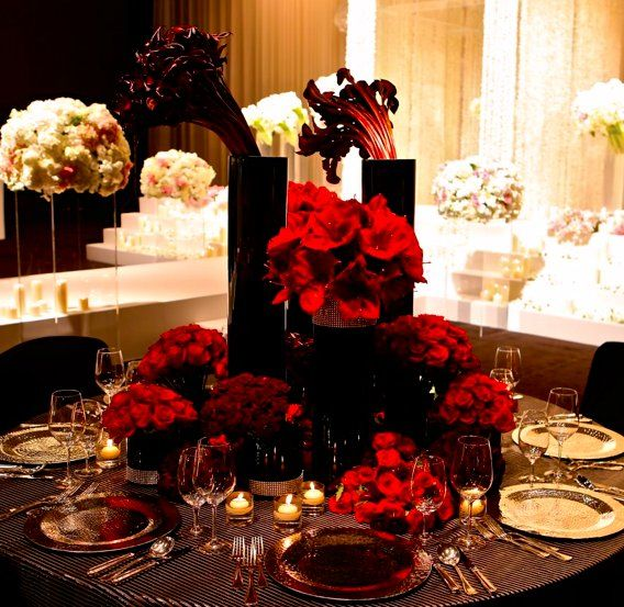 Pretty red roses with gold plate chargers for the tables