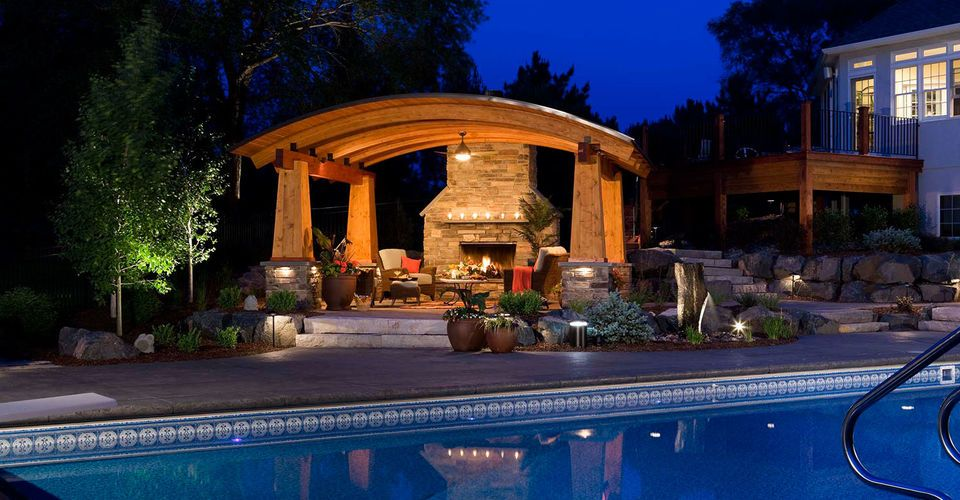 AFTER Fiery outdoor living room and illuminated swimming