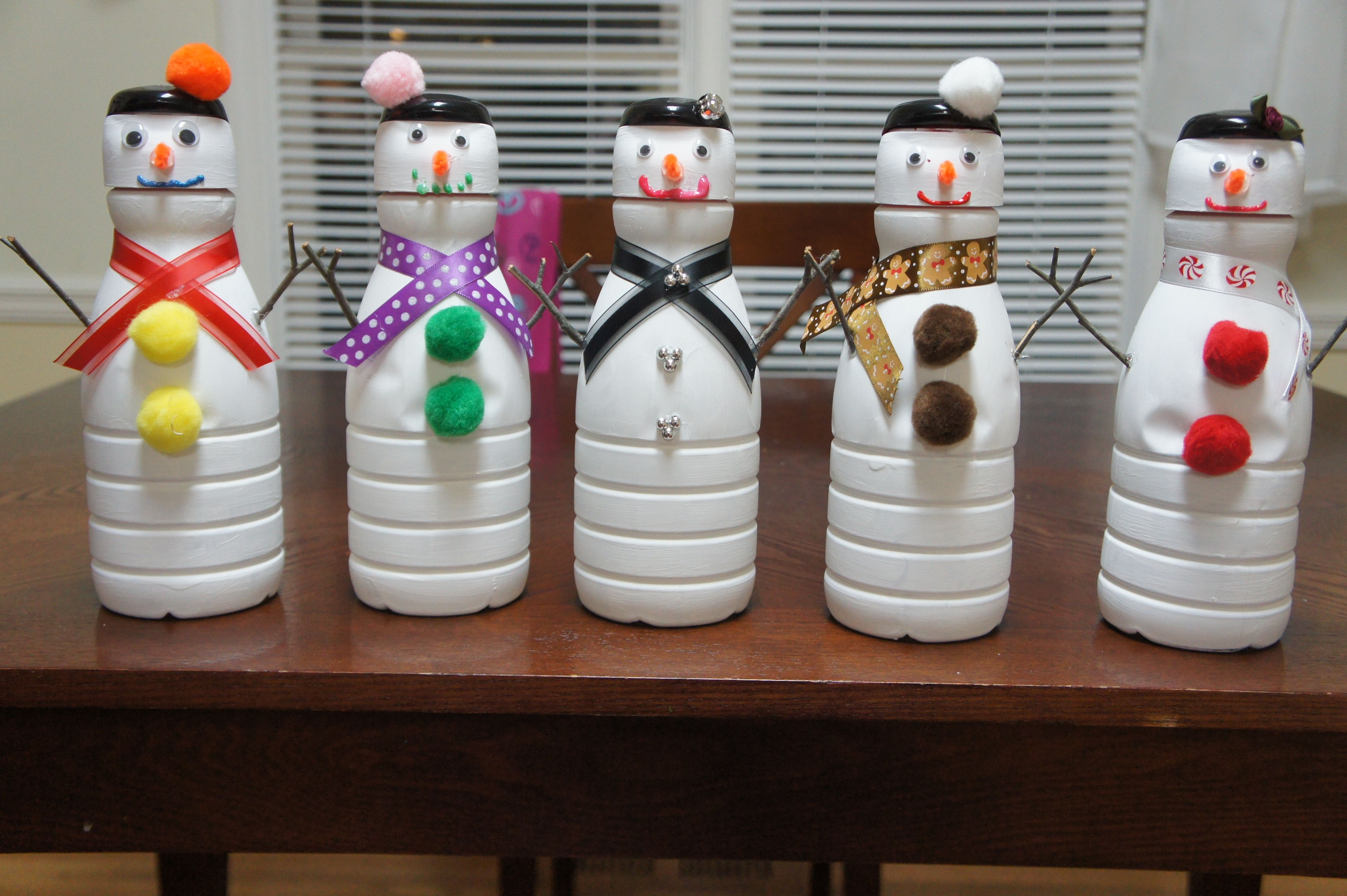 Snowmen made out of liquid coffee creamer containers for Empty bottle craft