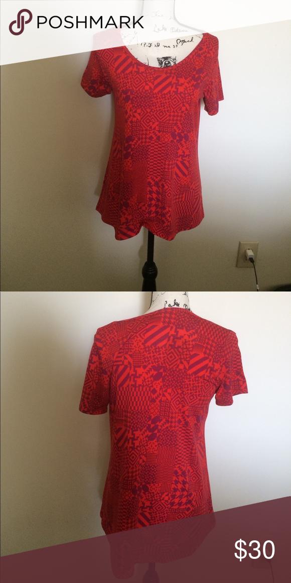 Lularoe Top Small Cute red with fun print Lularoe top! In great condition. Size small. LuLaRoe Tops Tees - Short Sleeve