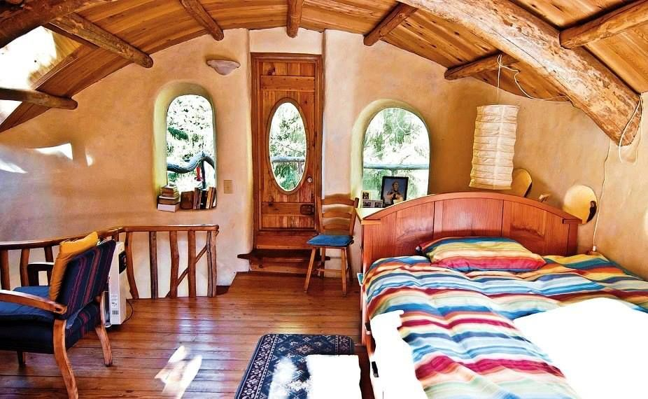 cob house with exposed beams.. love it