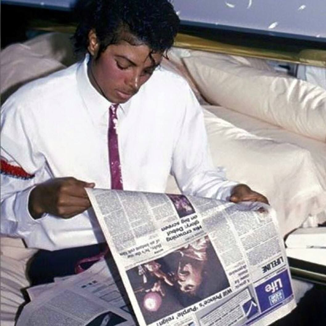Michael Jackson Reading A Newspaper Article About Prince