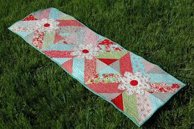 ! Sew we quilt: It's a month of runners and LOOK at what Amanda Blossoms for us...