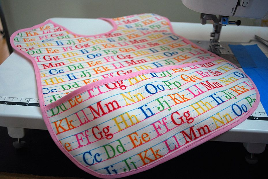 Extra-long baby bib free sewing pattern for toddler-sized spills