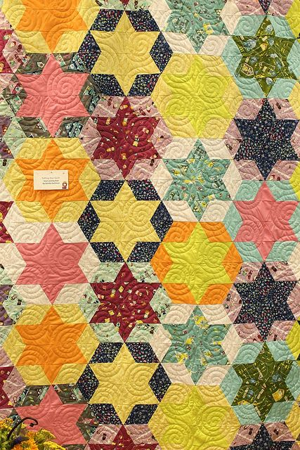 ever kelly quilt by madebyrae, via Flickr.  Not made with EPP.  diamonds and triangles pieced in horizontal strips.