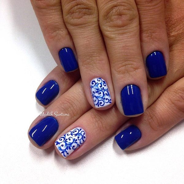 Intricate tribal themed nail art design. This design uses blue and white  polish as base - 50 Blue Nail Art Designs White Polish And Detail