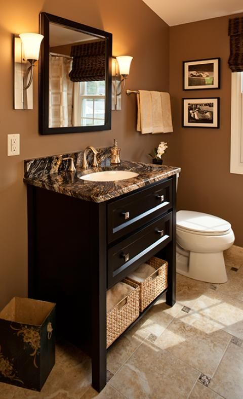 Traditional Bathroom With Brown And Black Marble Countertop
