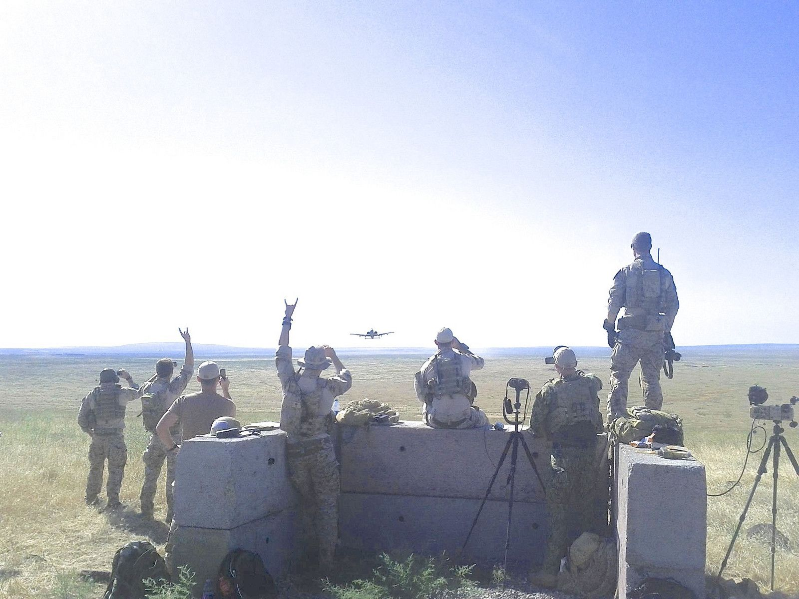 US Navy SEALs watch as an A10 Warthog approaches them to conduct a ...